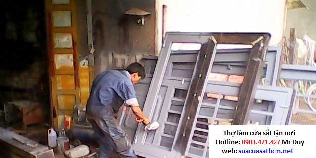 sửa cửa sắt